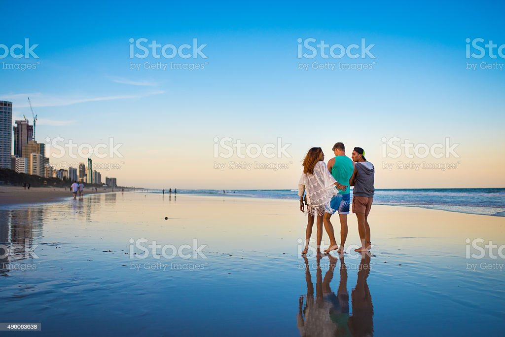 Friends having fun at the beach stock photo