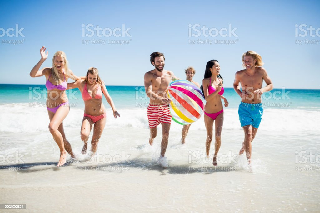 Friends having fun at the beach royalty-free stock photo