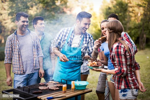 istock Friends having fun grilling meat enjoying bbq party 655786358