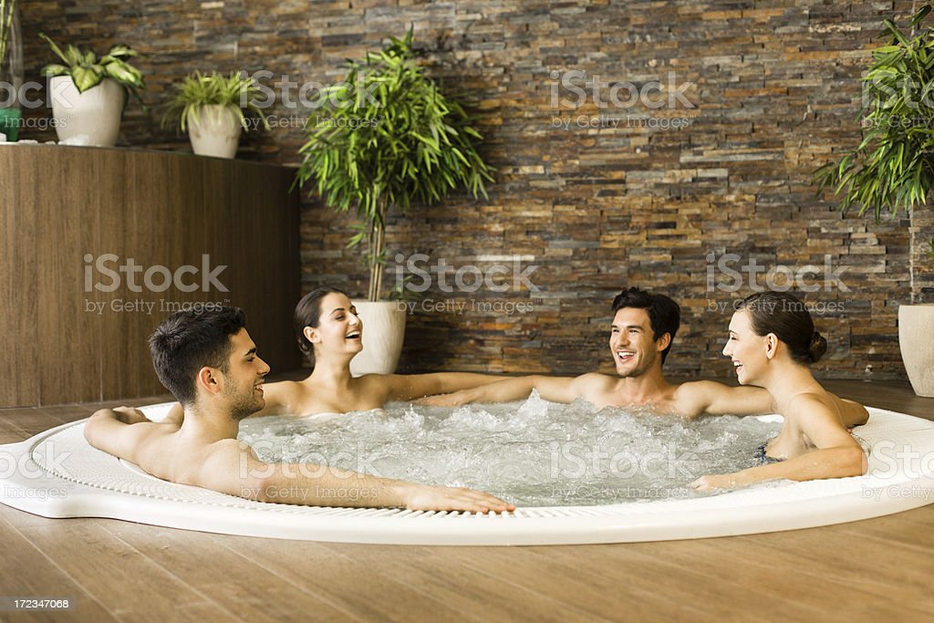Friends having fun in jacuzzi royalty-free stock photo