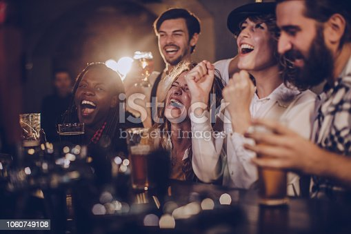 istock Friends having fun in pub 1060749108