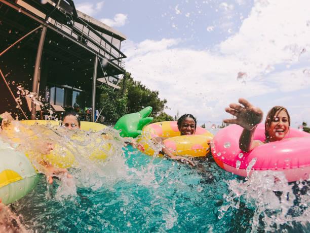 Friends having fun on floaties in swimming pool picture id994124958?b=1&k=6&m=994124958&s=612x612&w=0&h=d0z oggjppd  uqp7eole tf0tiir hwcyh7onocrb4=
