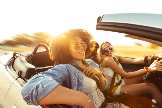 Friends having fun on road trip stock photo