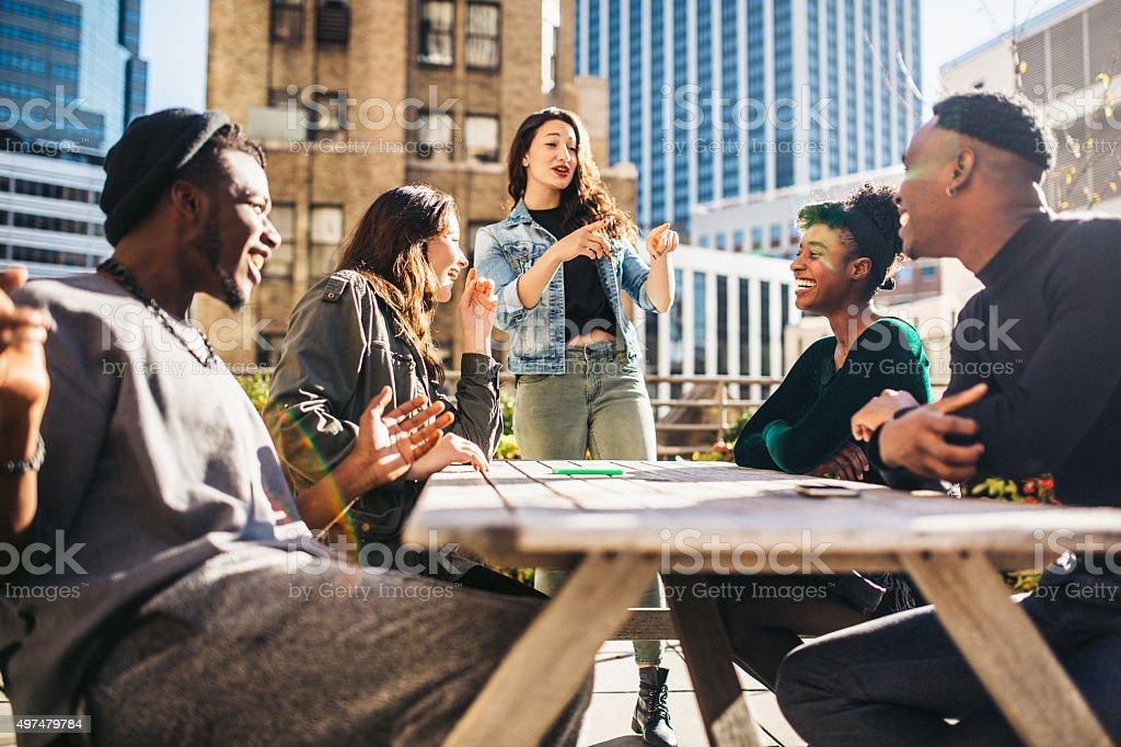 Friends Having Fun on Rooftop stock photo