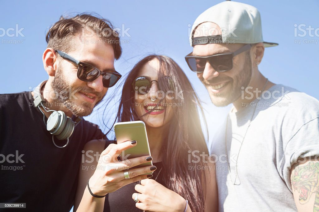 Friends having fun outdoors at the park royalty-free stock photo