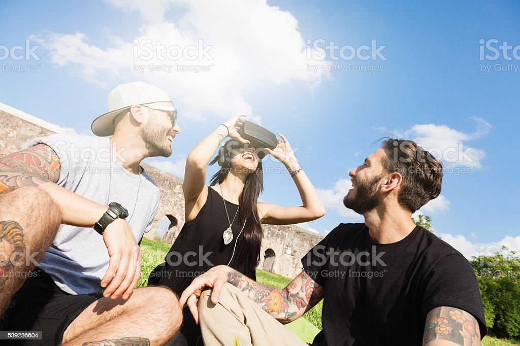 Friends having fun outdoors at the park with VR Headset royalty-free stock photo