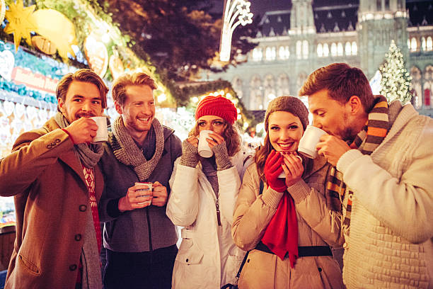 friends having fun outdoors at winter holidays. - mulled wine stock photos and pictures