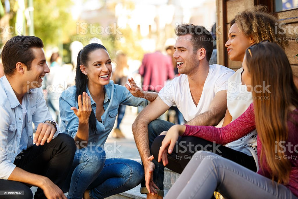 Friends having fun outdoors stock photo