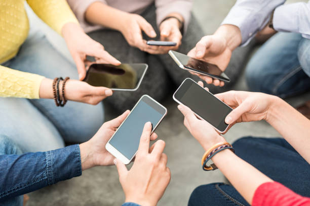 friends having fun together with smartphones. - mobile game stock photos and pictures
