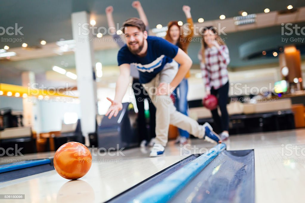 Friends having fun while bowling stock photo