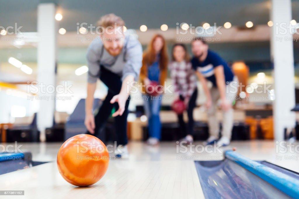 Friends having fun while bowling stock photo