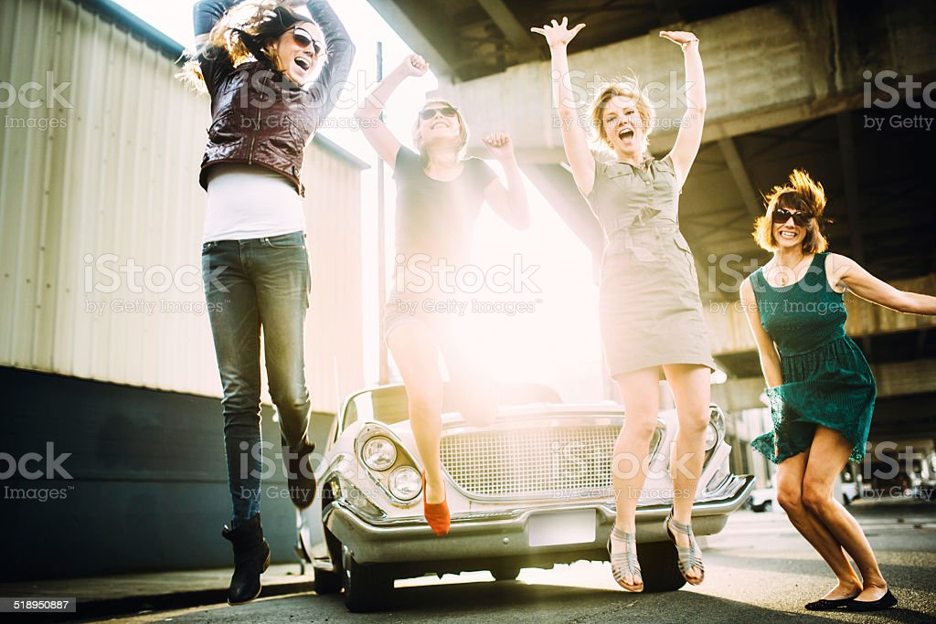 Friends Having Fun with Classic Car stock photo