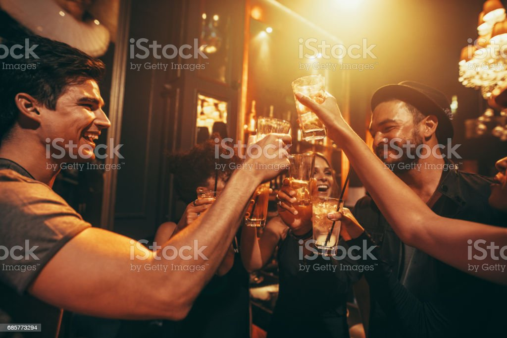 Friends having good time at club stock photo