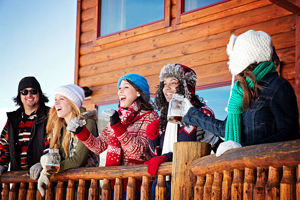 Friends Having Good Times After Skiing A group of friends having beer after skiing. apres ski stock pictures, royalty-free photos & images