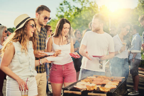 friends having outdoor party - grilled stock photos and pictures