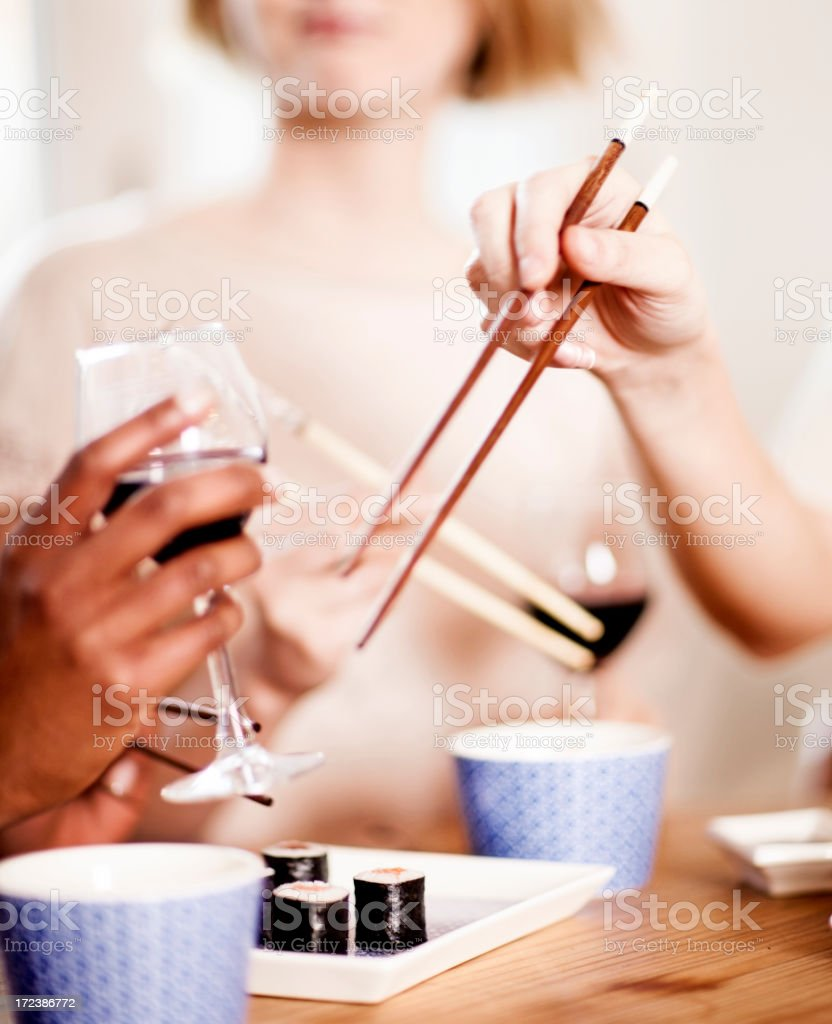 Friends having sushi royalty-free stock photo
