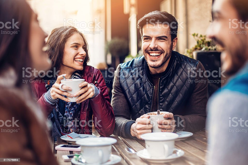 Friends having tea and coffee stock photo