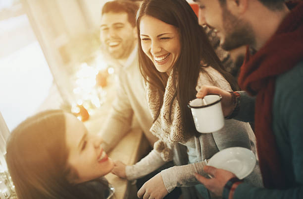 Friends having tea at coffee house. stock photo