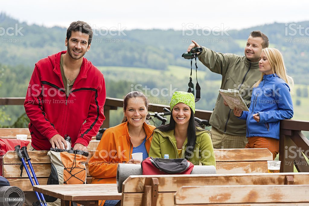 Friends hikers relax rest place mountain view royalty-free stock photo