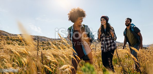 istock Friends hiking in countryside 1284552737