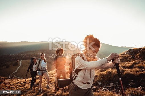 Close up of a group of friends hiking in the mountains