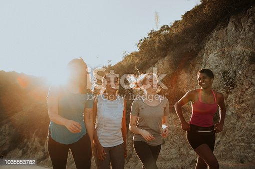 1051098428istockphoto Friends hiking through the hills of Los Angeles 1035553782