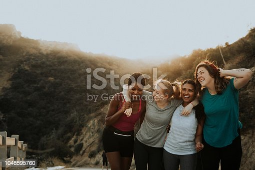 1051098428istockphoto Friends hiking through the hills of Los Angeles 1048595760