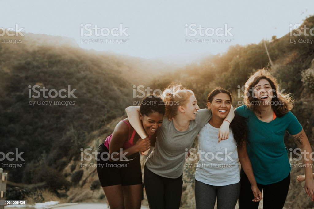 Friends hiking through the hills of Los Angeles stock photo
