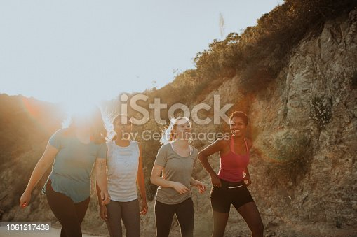 1051098428istockphoto Friends hiking through the hills of Los Angeles 1061217438
