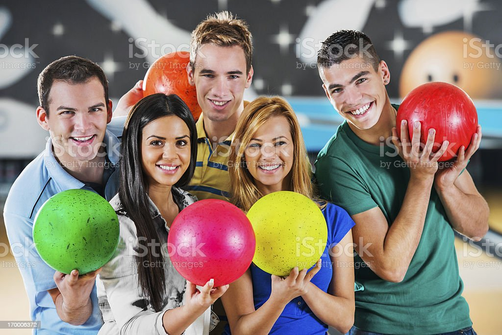 Friends holding bowling balls. stock photo