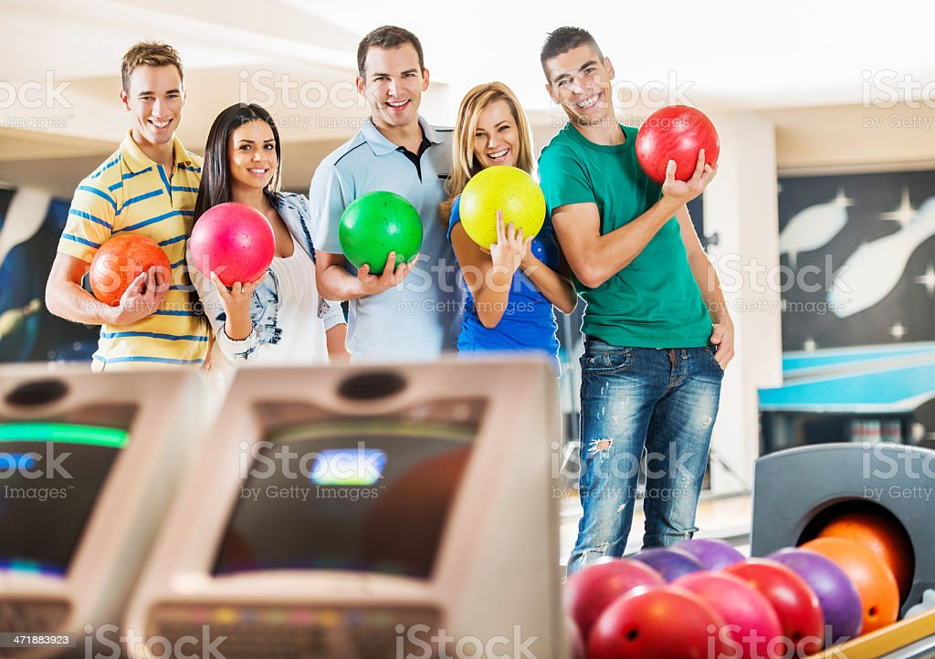 Friends holding bowling balls. royalty-free stock photo