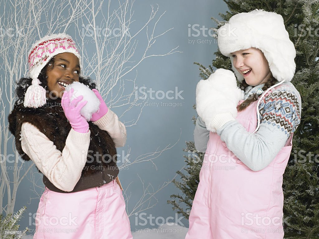 Friends holding snowballs royalty-free stock photo