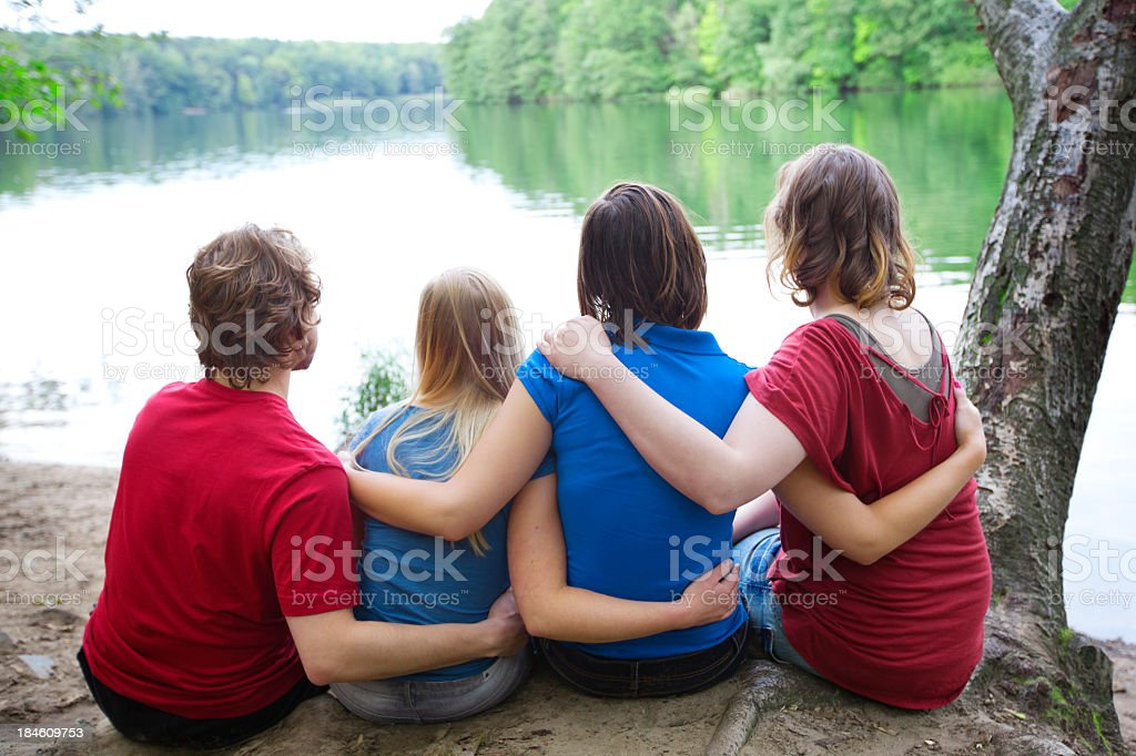 Friends hugging in the forest stock photo