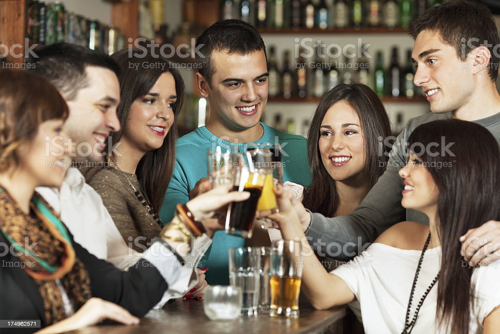 Friends in a bar royalty-free stock photo