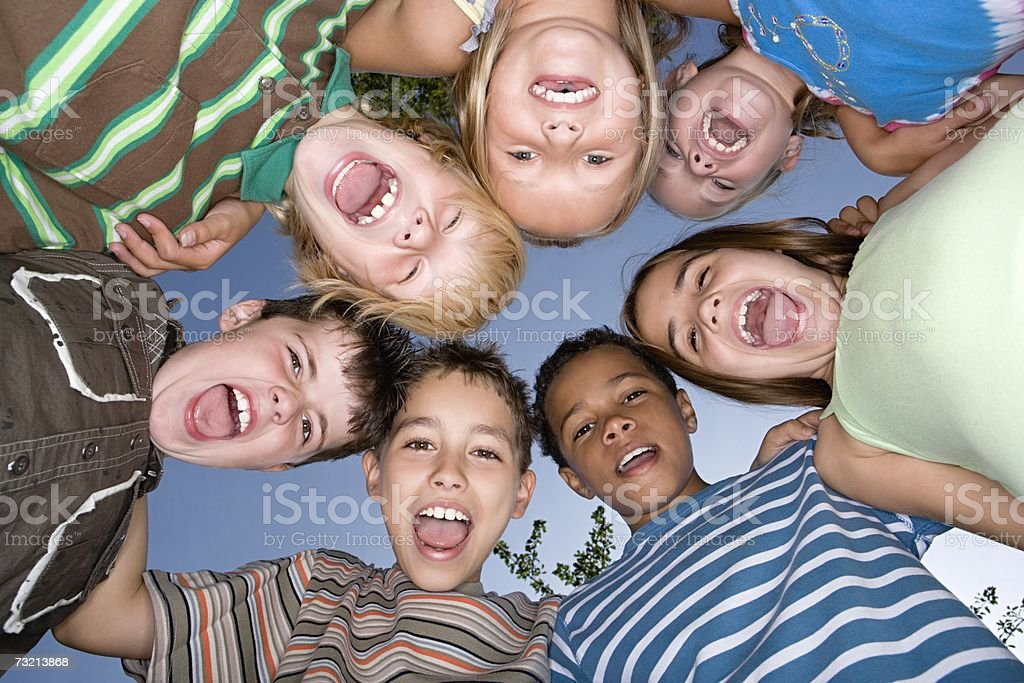 Amigos em um huddle foto de stock royalty-free