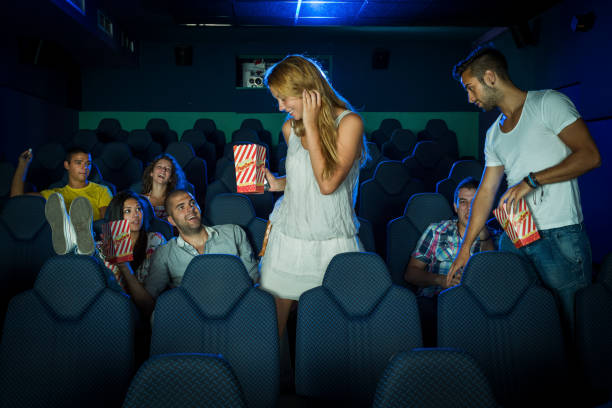 Friends in a movie theater stock photo