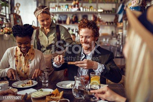 istock Friends in a Restaurant 1177771001