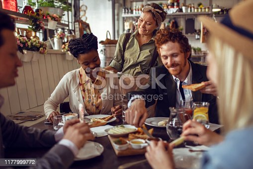 istock Friends in a Restaurant 1177999772