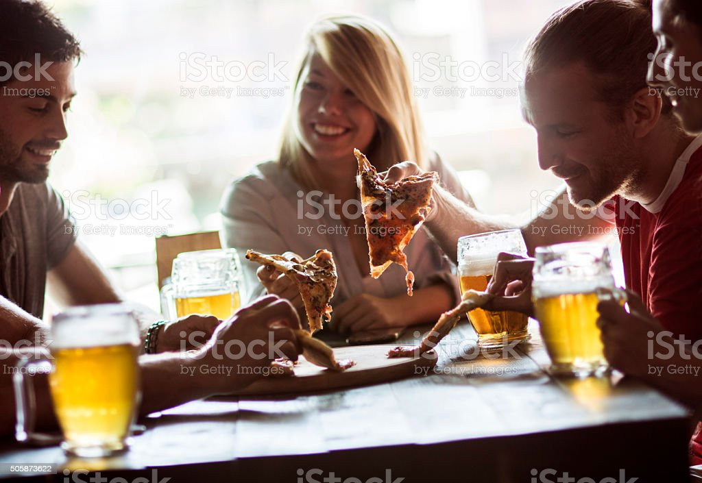 Friends in a restaurant stock photo