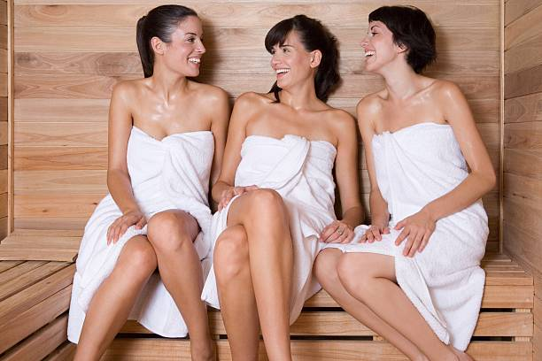 Friends in a sauna  sauna stock pictures, royalty-free photos & images