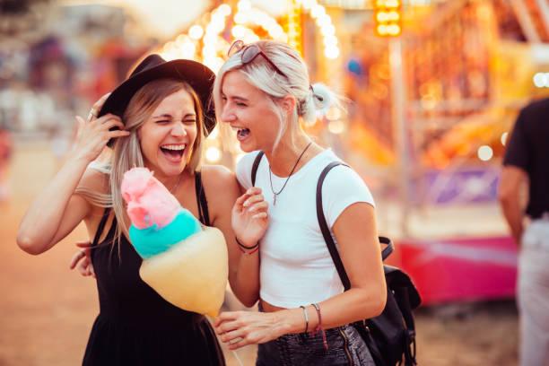 Friends in amusement park stock photo