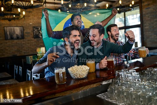 Friends in bar watching game
