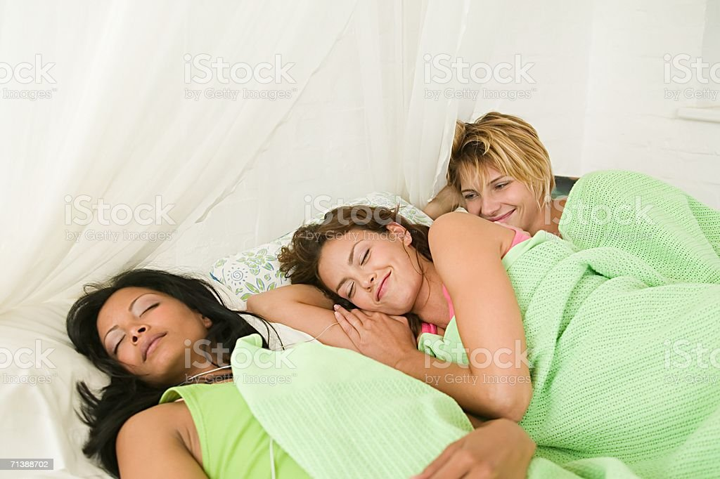 Friends in bed together royalty-free stock photo