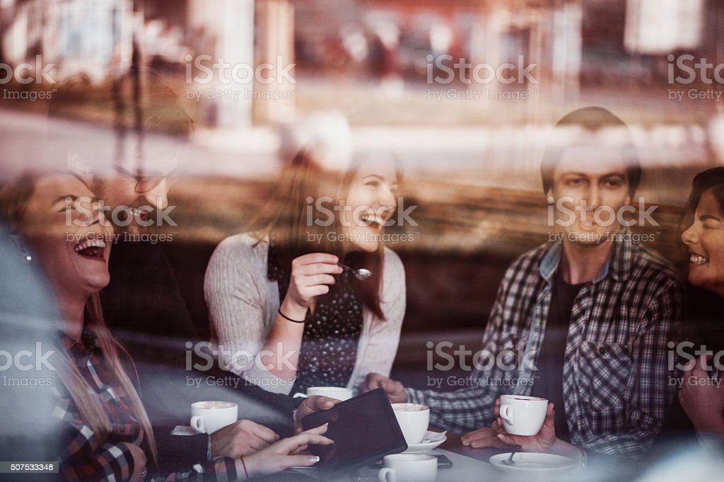 Friends In Cafe Drinking Coffee stock photo