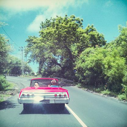 Three friends in the retro car - MobileStock