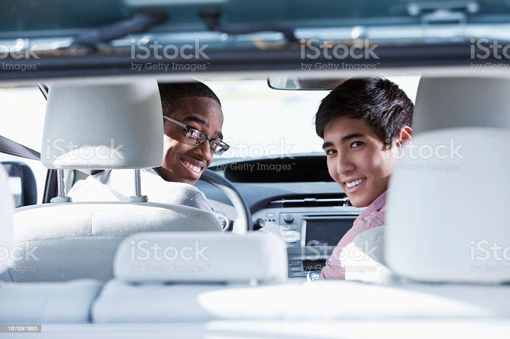 Friends in car stock photo