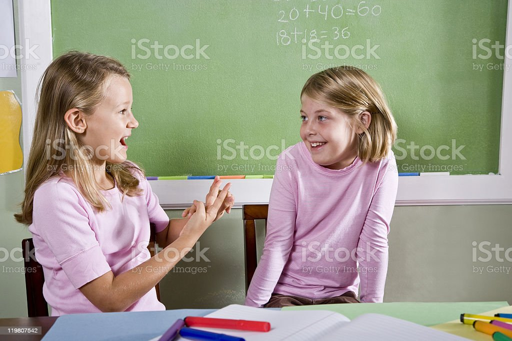Friends in class talking stock photo