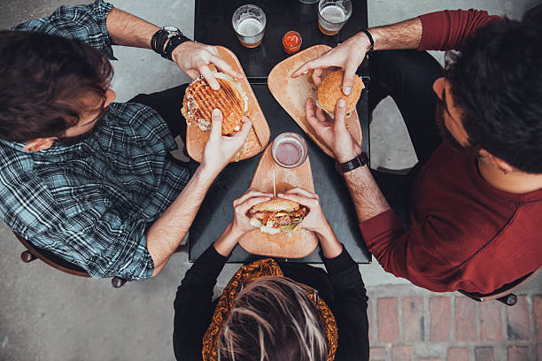 Friends In Fast Food Restaurant stock photo