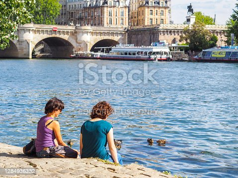 istock Friends in front of Pont Neuf in Paris 1284936332