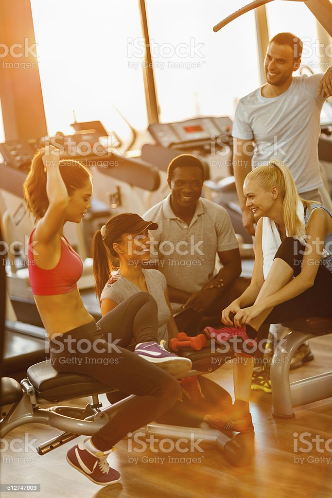 Friends in gym Close up of a friends relaxing after workout 20-29 Years Stock Photo